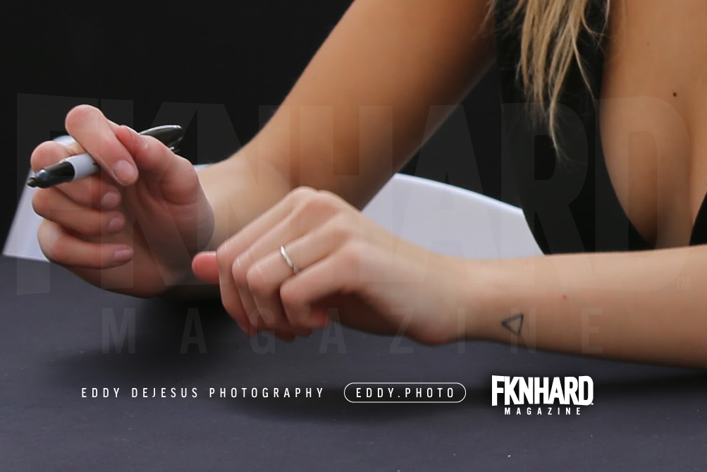 EddyDeJesus-Photography-Fknhard-Magazine-Sports-Illustrated-Swimsuit-hailey-clauson-interview-magazine-smiling-signing-sharpie-penrose-triangle-tattoo-fire-water