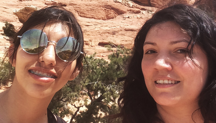fknhard-magazine-red-rock-las-vegas-nevada-hiking-mountain-climbing-trail-runner-hike-valentina-zuniga-red-tanktop-shirt-pride-rock-cliff-bushes-blue-skies-two-models-redrock-two-girls-vegas