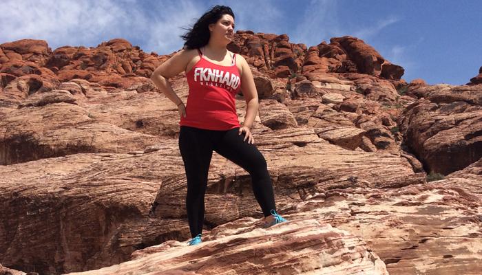 fknhard-magazine-red-rock-las-vegas-nevada-hiking-mountain-climbing-trail-runner-hike-valentina-zuniga-red-tanktop-shirt-pride-rock-cliff