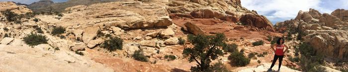 fknhard-magazine-red-rock-las-vegas-nevada-hiking-mountain-panoramic-wide-lens-climbing-trail-runner-hike-valentina-zuniga-red-tanktop-shirt-cliff-bushes-blue-skies-two-vegas-girls